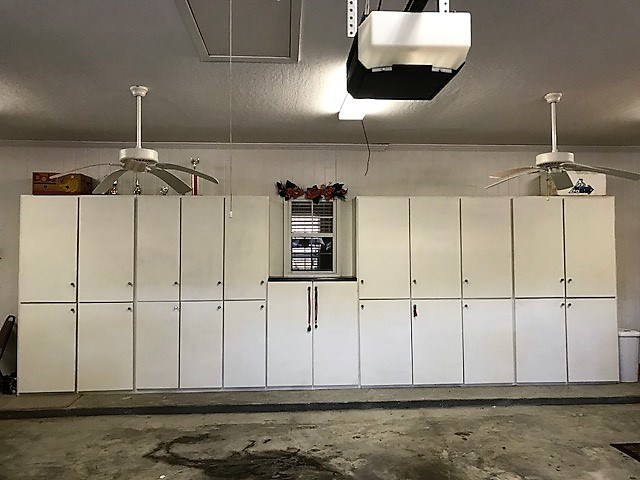 3 car garage has a whole wall of cabinets!