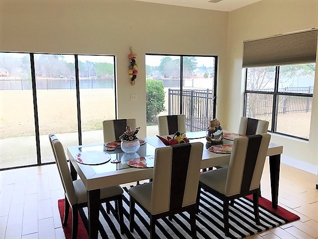 Formal dining room with view of lake