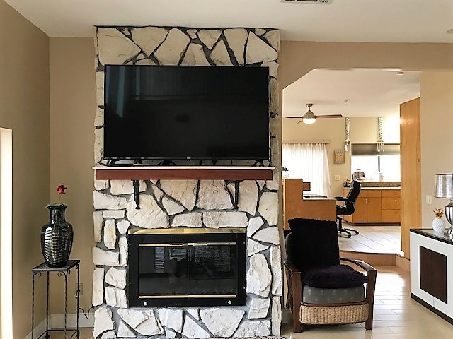 Dual sided gas log fireplace in den/dining