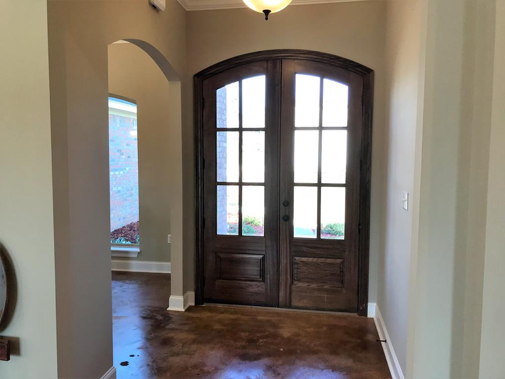 Beautiful entry with double curved doors.